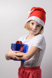 Little girl with Christmas gifts Royalty Free Stock Image