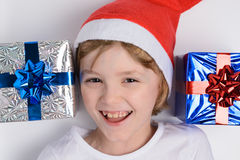 Little girl with Christmas gifts Stock Photos