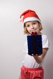 Little girl with Christmas gifts Stock Images