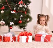 Little girl with Christmas gifts Stock Image