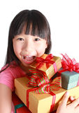 Little girl with christmas gifts. Royalty Free Stock Image