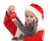 Little girl in Christmas hat Stock Images