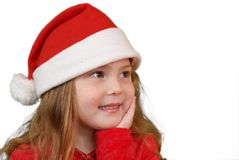 Little girl in Christmas hat Stock Photos