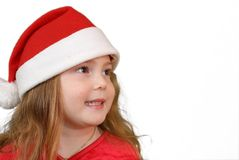 Little girl in Christmas hat Stock Photography