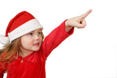 Little girl in Christmas hat Royalty Free Stock Images