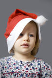 Little girl in Christmas hat Royalty Free Stock Image