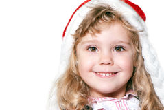 Little girl in Christmas hat Stock Photo