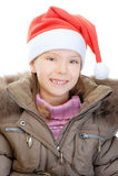 Little girl in Christmas hat Stock Photo