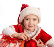 Little girl in christmas hat with ball Royalty Free Stock Image