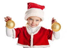 Little girl in christmas hat with balls Stock Images