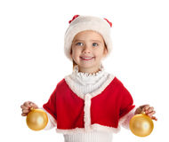 Little girl in christmas hat with balls Stock Photos