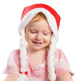 Little girl in a Christmas hat Royalty Free Stock Image