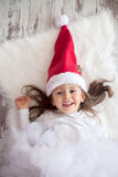 Little girl with christmas hat Stock Photography