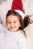 Little girl with christmas hat Royalty Free Stock Photography