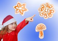 Little girl in Christmas hat pointing Royalty Free Stock Photo