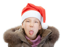 Little girl in Christmas hat show Royalty Free Stock Images