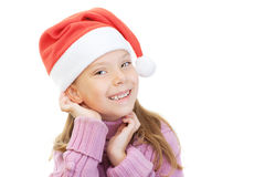 Little girl in Christmas hat smiles Royalty Free Stock Photos