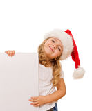 Little girl with christmas hat and white banner Stock Photography