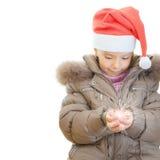 Little girl Christmas hatkeeps Stock Photos