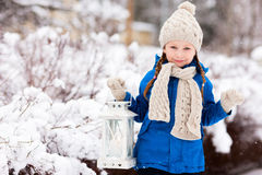 Little girl with Christmas lantern Royalty Free Stock Photography