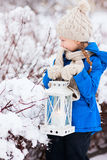 Little girl with Christmas lantern Stock Images