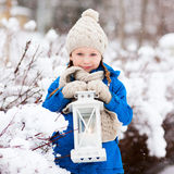 Little girl with Christmas lantern Stock Photo