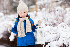 Little girl with Christmas lantern Stock Photos