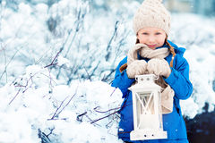 Little girl with Christmas lantern Stock Image