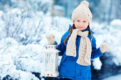 Little girl with Christmas lantern Royalty Free Stock Images