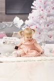 Little girl and christmas magic Stock Image