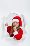 Little girl in christmas outfit telling you a secret Royalty Free Stock Photos