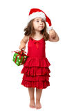 Little girl with Christmas present Stock Photos