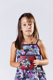 Little girl with a christmas present Stock Image