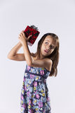 Little girl with a christmas present Royalty Free Stock Photo