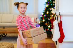 Little girl with Christmas presents Stock Photos