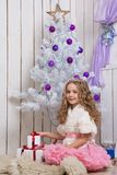 Little girl with christmas presents Royalty Free Stock Image