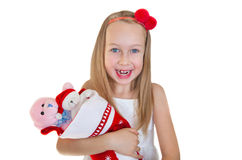 Little girl with Christmas presents Royalty Free Stock Photos