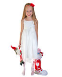 Little girl with Christmas presents Stock Images