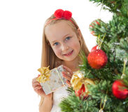 Little girl with Christmas presents Royalty Free Stock Photography