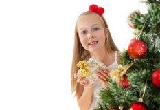 Little girl with Christmas presents Stock Photo