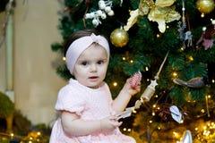 Little girl in Christmas room stock image