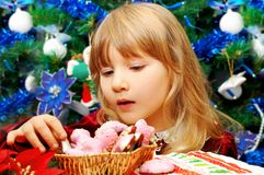 Little girl in christmas time Stock Image