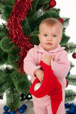 Little girl at Christmas time Stock Image