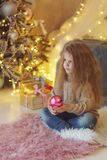 Little girl with christmas toy. stock photos