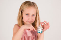 Little girl with christmas toy Stock Photos