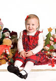Little girl with christmas toys Stock Photos