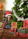 Little girl with Christmas tree. Little girl with thumps up  behind Christmas tree Royalty Free Stock Image