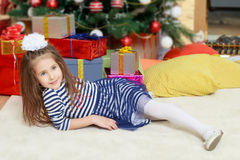 The little girl in the Christmas tree. Stock Images
