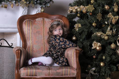 Little girl  at the Christmas tree Stock Photo