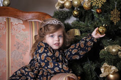 Little girl  at the Christmas tree Royalty Free Stock Image